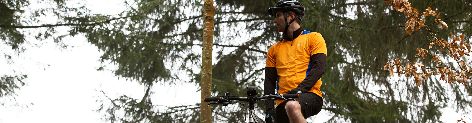 man-on-bike-in-woods.jpg